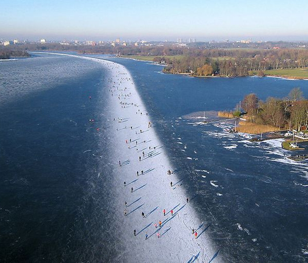 Ice Skaters on Paterswoldsemeer Lake, Groningen, The Netherlands