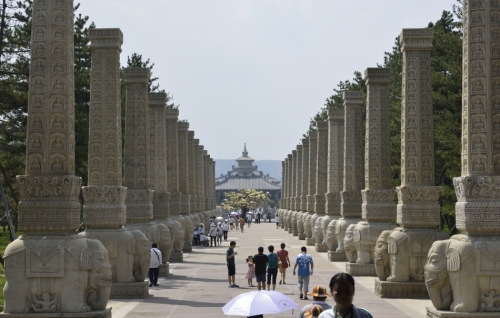 Elephant Riding Pillars on Buddha Avenue