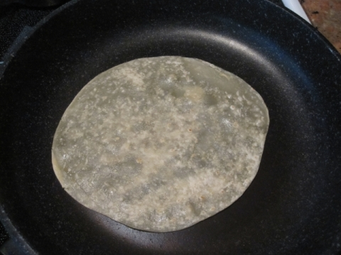 Cook tortilla in medium to low heat