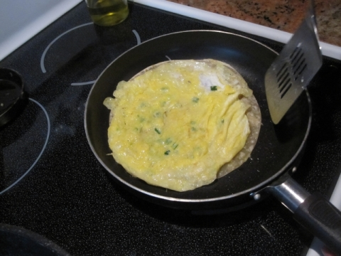 Flip tortilla and egg over so egg is now on top