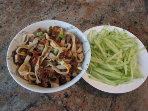 Zhajiang noodle served with cucumber strips