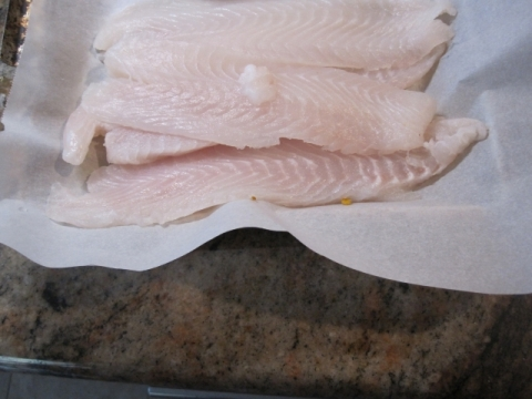 Slice each Tilapa fillet horizontal to flat surface into two thinner fillets